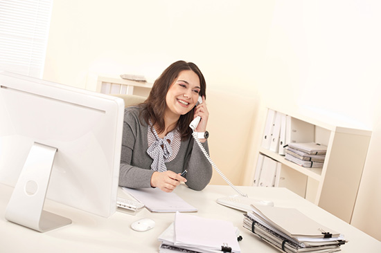 Girl Talking on VoIP Provider Phone